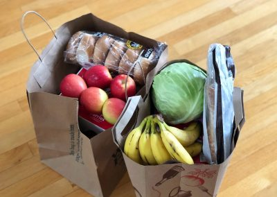 apples and bananas in brown paper bags